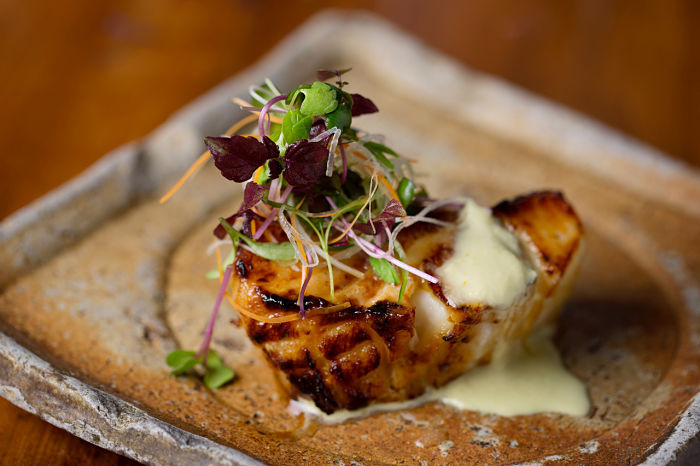 Grilled Chilean Sea Bass with Green Chilli, Ginger Dressing.